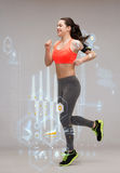 Sporty woman running or jumping. Fitness, sport and dieting concept - beautiful sporty woman running or jumping Royalty Free Stock Photo