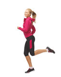 Sporty woman running or jumping Stock Images