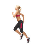 Sporty woman running or jumping Stock Image