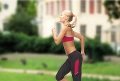 Sporty woman running or jumping Royalty Free Stock Photography