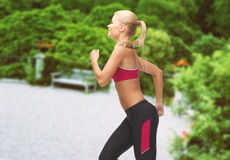 Sporty woman running or jumping Royalty Free Stock Photo