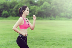 Sporty woman running Royalty Free Stock Photos