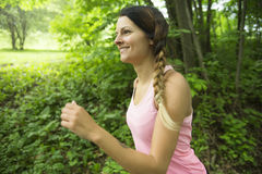 Sporty woman running outdoors in park. A sporty woman running outdoors in park Royalty Free Stock Image