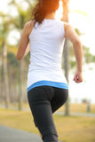 Sporty woman running at park Stock Image