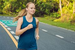 Sporty woman running on road at sunrise. Fitness and workout wellness concept.  stock images