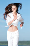 Sporty woman running in sea coast Royalty Free Stock Photography