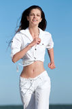 Sporty woman running in sea coast Stock Image