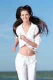 Sporty woman running in sea coast Stock Photos