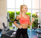Sporty woman running with smartphone and earphones Stock Photos