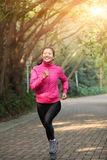 Sporty woman running at trail Royalty Free Stock Photo