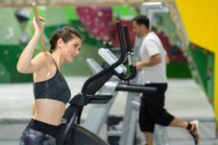 Sporty woman running on treadmills at gym. Sporty women running on treadmills at the gym Royalty Free Stock Image