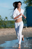 Sporty woman running on water Stock Photo