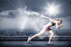 Composite image of sporty woman running on a white background Stock Images