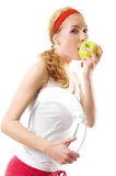 Sporty woman with scale and green apple Royalty Free Stock Photography