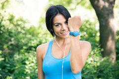 Sporty woman showing activity tracker on hand Royalty Free Stock Photos