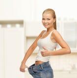 Sporty woman showing big pants Stock Photos