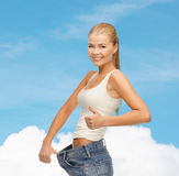 Sporty woman showing big pants Royalty Free Stock Image