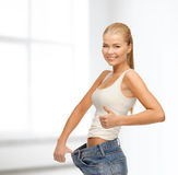 Sporty woman showing big pants Royalty Free Stock Photos