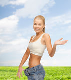 Sporty woman showing big pants Stock Photos