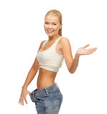 Sporty woman showing big pants. Picture of sporty woman showing big pants Stock Photography