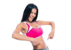 Sporty woman showing fingers at her belly Stock Photos