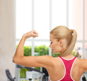 Sporty woman showing her biceps Stock Photography