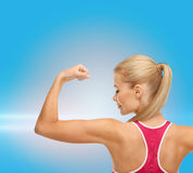 Sporty woman showing her biceps Stock Photos