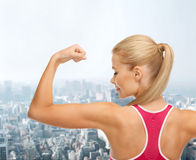 Sporty woman showing her biceps Stock Images