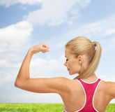 Sporty woman showing her biceps Stock Image