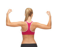 Sporty woman showing her biceps Royalty Free Stock Photography