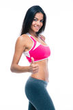 Sporty woman showing thumb up sign Royalty Free Stock Photo