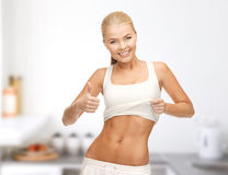 Sporty woman showing thumbs up Stock Photo