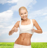 Sporty woman showing thumbs up Royalty Free Stock Photos