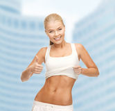 Sporty woman showing thumbs up Stock Image