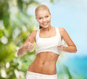 Sporty woman showing thumbs up Stock Photos