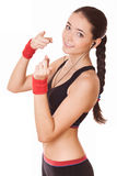 Sporty woman shows towards you Royalty Free Stock Photography
