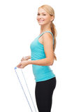 Sporty woman with with skipping rope Royalty Free Stock Photography