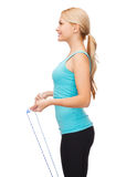 Sporty woman with with skipping rope Royalty Free Stock Photos