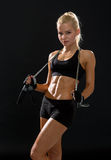 Sporty woman with skipping rope Royalty Free Stock Photos