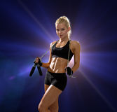 Sporty woman with skipping rope Royalty Free Stock Photo