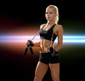 Sporty woman with skipping rope Stock Image