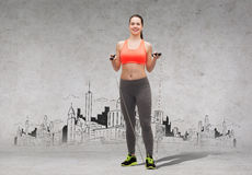 Sporty woman with skipping rope Royalty Free Stock Images