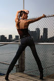 Sporty woman with a skyline. Young girl on the urban view stock image