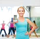 Sporty woman with smartphone Stock Images