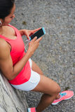 Sporty woman with smartphone and earphones Stock Image