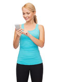 Sporty woman with smartphone Stock Photo
