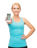 Sporty woman with smartphone royalty free stock photography