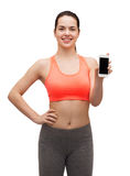 Sporty woman with smartphone Stock Photos