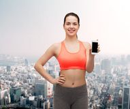 Sporty woman with smartphone Royalty Free Stock Photo