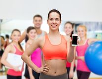Sporty woman with smartphone Royalty Free Stock Image